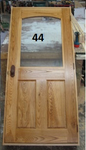 Arched glass hardwood door