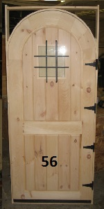 Frame and panel arch top door